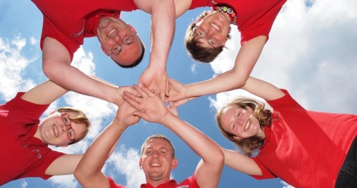 Teamfoto Outdoortrainer Hände